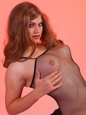 Pretty Tiffany posing in naughty fishnet body stockings